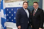 Left: Mathieu Charbonneau, Executive Director, CargoM; Right: Jean D'Amour, Minister for Maritime Affairs and Minister responsible for the Bas-Saint-Laurent region (CNW Group/CargoM)