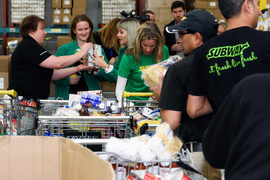 Subway® Canada employees celebrated World Sandwich Day by volunteering with Food Banks Canada. Subway donated more than 13.3 million meals to 20 hunger-relief charities around the world, including 1 million meals to Food Banks Canada. (Photo/ Bard Azima of LivingFace Photography)