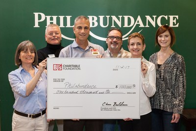 Mike Visco, General Manager of BJ's Wholesale Club in Philadelphia, Pa. (third from left) presents a $100,000 donation from BJ's Charitable Foundation to Philabundance.