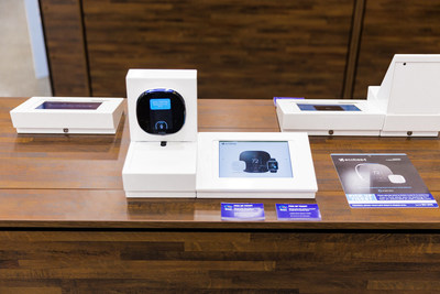 Products are displayed out of the box to encourage hands-on play and enhance product knowledge. iPads with product-related content and pricing details can be found alongside each device.