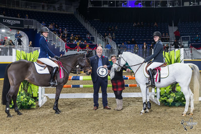 Marion Cunningham and Bill Tilford of MarBill Hill Farm present Grace Munro (left) aboard Ever So Clever and Makayla Clarke (right) aboard Twisted as co-winners of $5,000 MarBill Hill Royal Pony Jumper Final on Sunday, November 5, at the Royal Horse Show in Toronto, ON. Photo by Ben Radvanyi Photography (CNW Group/Royal Agricultural Winter Fair)