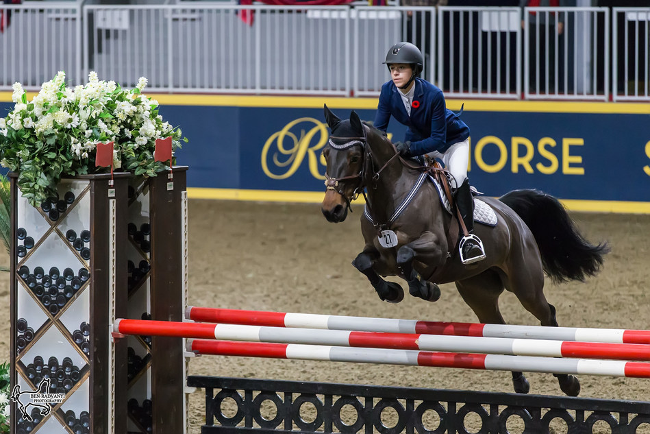 Grace Munro of Wolfville, NS, tied for first in the $5,000 MarBill Hill Royal Pony Jumper Final riding Ever So Clever on Sunday, November 5, at the Royal Horse Show in Toronto, ON. Photo by Ben Radvanyi Photography (CNW Group/Royal Agricultural Winter Fair)