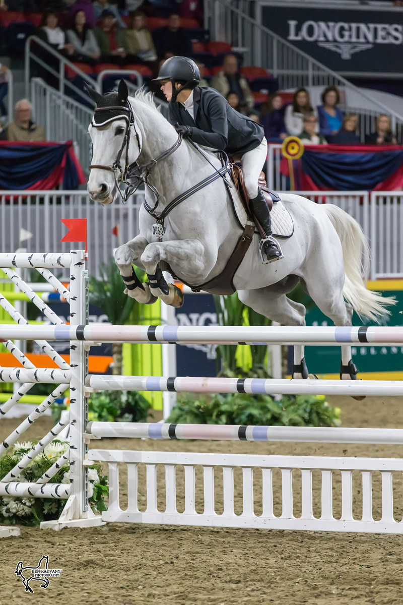Julia Madigan of Vancouver, BC, won the $10,000 Junior/Amateur 1.40m Jumper Stake riding Farfelu du Printemps on Sunday, November 5, at the Royal Horse Show in Toronto, ON. Photo by Ben Radvanyi Photography (CNW Group/Royal Agricultural Winter Fair)