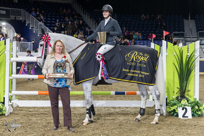 Julia Madigan and Farfelu du Printemps were presented with the Canadian Equestrian Team Challenge Trophy as the Junior/Amateur Jumper Champions by Karen Hendry-Ouellette of Equestrian Canada, on Sunday, November 5, at the Royal Horse Show in Toronto, ON. Photo by Ben Radvanyi Photography (CNW Group/Royal Agricultural Winter Fair)