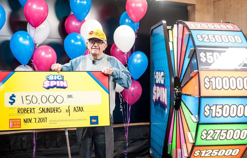 Robert (Bob) Saunders of Ajax celebrates after spinning THE BIG SPIN Wheel at the OLG Prize Centre in Toronto to win $150,000. Saunders won a top prize with OLG's new INSTANT game – THE BIG SPIN. (CNW Group/OLG Winners)