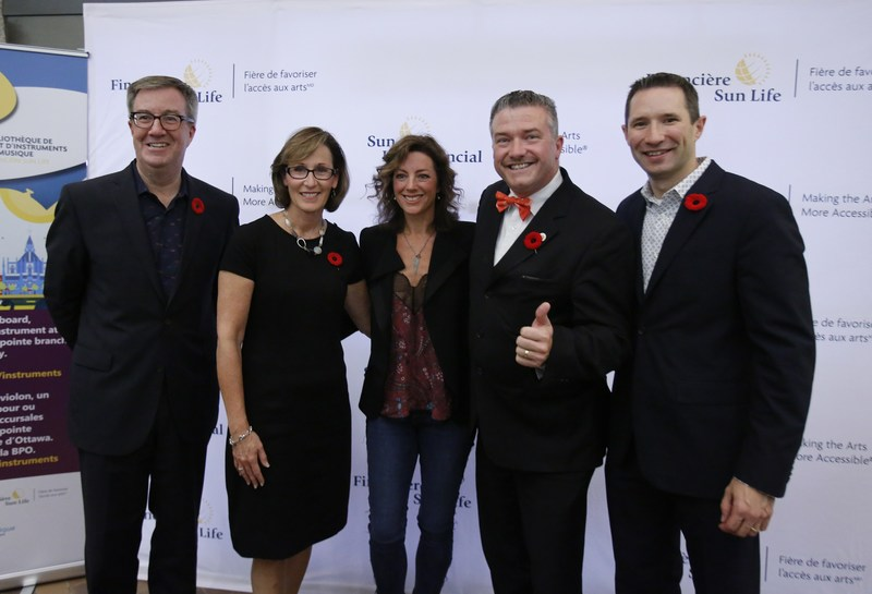 Sun Life Financial launches the expansion of the Sun Life Financial Musical Instrument Lending Library program to the Ottawa Public Library. From left to right, Mayor Jim Watson, City of Ottawa, Danielle McDonald, CEO, Ottawa Public Library; Grammy and Juno-Award winning Canadian music icon Sarah McLachlan; Tim Tierney, Chair, Ottawa Public Library; and Paul Joliat, Assistant Vice-President, Philanthropy & Sponsorships, Sun Life Financial. (CNW Group/Sun Life Financial Inc.)