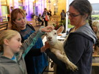 Photo of Rebecca Parker and lamb – R.I. Tennison photo (CNW Group/Royal Agricultural Winter Fair)