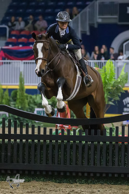 Erynn Ballard of Tottenham, ON, and Enchanted won the $25,000 Knightwood Hunter Derby on Tuesday, November 7, at the Royal Horse Show in Toronto, ON. Photo by Ben Radvanyi Photography (CNW Group/Royal Agricultural Winter Fair)