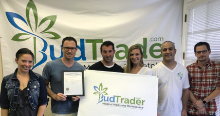 The BudTrader.com team holding their US Trademark.