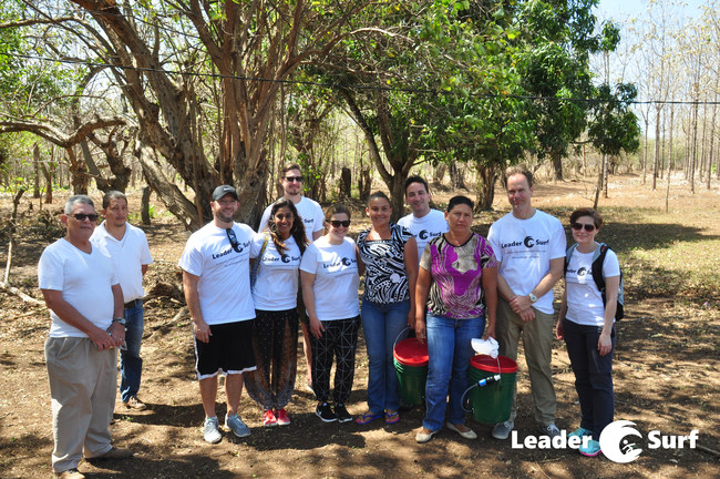 LeaderSurf participants with a Nicaraguan family that just received two clean water filter kits as part of the LeaderSurf clean water humanitarian aid project. Modelling servant leadership and giving back to a community is an important component of the LeaderSurf program.