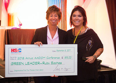 From left are Michele Penrose, Director of Global Professional Relations for Henry Schein, Inc., and Ruby Eaches, Practice Manager for North Carolina-based Surf City Dental. Ms. Eaches is the winner of the American Association of Dental Office Management's fifth annual Green Leader Award. AADOM created the award as part of its Green Leader Initiative, which was made possible by a grant from the Henry Schein Cares Foundation.