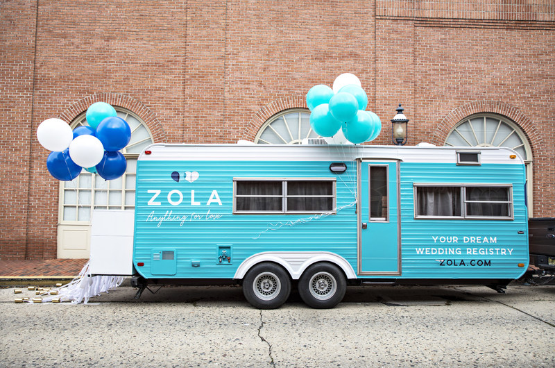 "Zola's ""Registry on Wheels"" is hitting the road on a ""Love Stories Tour"" and will be making stops in NYC (11.11), Chicago (11.15) and D.C. (11.18) to collect everyday love stories in collaboration with Modern Love, the podcast based on the New York Times' popular series of weekly reader-submitted essays that explore the joys and tribulations of love."