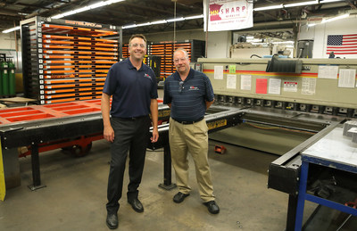 Ajax Metal Forming Solutions Vice President of Sales Don Wellman (left) and Ajax President Kent Djubek have announced that Heartland Equity Partners of Brooklyn Center, Minnesota has acquired a majority ownership position in their advanced manufacturing company.