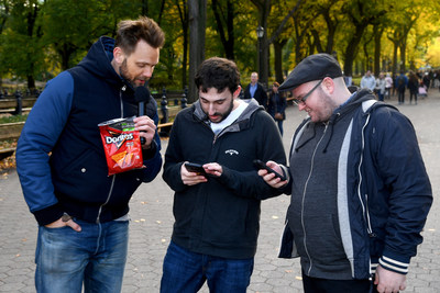 Joel McHale gifts new Xbox One X consoles in New York City to winning players in Mtn Dew, Doritos and Xbox Drop Zone, the first of this weekend's nationwide, augmented reality capture-the-flag contests. (PRNewsfoto/Frito-Lay North America)