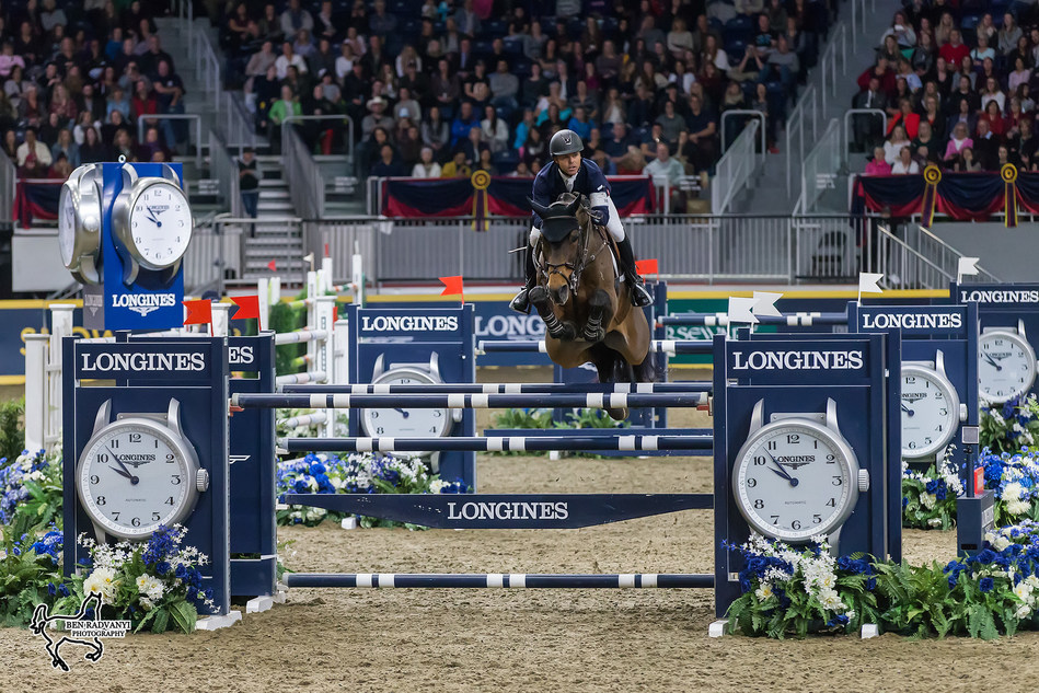 World number one Kent Farrington of the United States claimed the $150,000 Longines FEI World Cup™ Jumping Toronto riding Voyeur on Wednesday night, November 8, at the CSI4*-W Royal Horse Show in Toronto, ON. Photo by Ben Radvanyi Photography (CNW Group/Royal Agricultural Winter Fair)