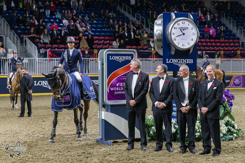 Kent Farrington of the United States aboard Voyeur, presented as winners of the $150,000 Longines FEI World Cup™ Jumping Toronto by, from left to right, Andrew McKee, President and Chairman of the Board of The Royal Agricultural Winter Fair; Charlie Johnstone, CEO of The Royal Agricultural Winter Fair; Iain Gilmour, Chairman of the Royal Horse Show; and Mark Samuel, FEI Bureau Member and Chair of Regional Group IV, on Wednesday, November 8, at the CSI4*-W Royal Horse Show. Photo by Ben Radvanyi (CNW Group/Royal Agricultural Winter Fair)