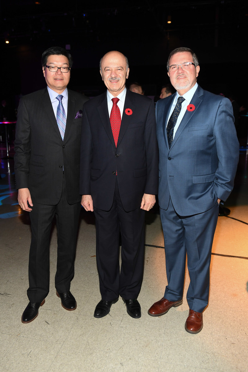 Ontario Minister of Research, Innovator and Science, Reza Moridi (centre) joins the Ontario Science Centre's Board Chair, Brian Chu (left), and CEO, Maurice Bitran, at the 2017 RBC Innovators' Ball, which netted a record $600,000 to support the Ontario Science Centre and its vital community access programs. (CNW Group/Ontario Science Centre)