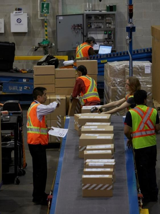 Purolator's 112 shipping centres will move close to 20 million packages, weighing about 120 million pounds, across Canada, into the United States and around the world this holiday season. (CNW Group/Purolator Inc.)