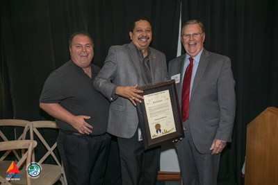 Left to right-Larry Elizondo, Alirio Zambrano, Mayor Joe McComb with the proclamation, recognizing Nov. 8 as STEM Day.