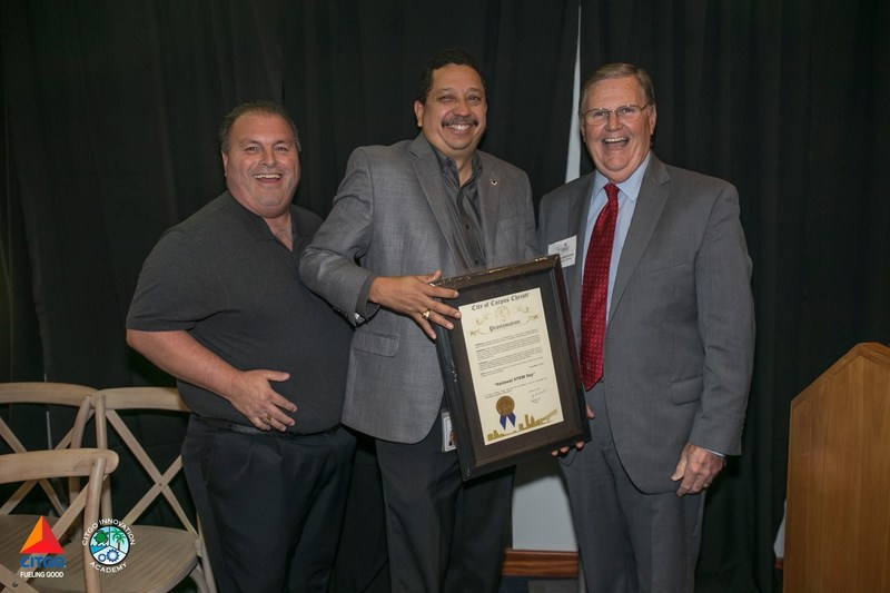 Left to right-Larry Elizondo, Alirio Zambrano, Mayor Joe McComb with the proclamation, recognizing Nov. 8 as STEM Day.