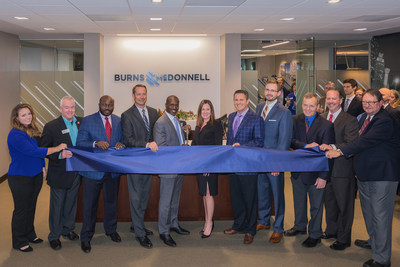 Engineering, architecture, construction, environmental and consulting firm, Burns & McDonnell, celebrated the completion of its Atlanta office expansion with a ceremonial ribbon cutting with Metro Chamber of Commerce representative. Pictured left to right: KayLa Marti, Jack Murphy (Metro Atlanta Chamber of Commerce), Dotun Famakinwa, Scott Feuerborn, Oko Buckle, Tara McCullen, Paul Fischer, Nathan Newman, Shawn DeKold, Joe Leggio and Hill Baughman.