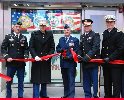 Reps of all United States military services cut the ceremonial ribbon for the reopening of the Times Square recruiting station. From left to right; LTC Judd Floris, Commander, NYC Army Recruiting Battalion; COL Ivan Monclova, Commander, 1st Marine Corp District; MG Garrett Harencak, Commander, Air Force Recruiting Service; COL Robert Hailey, Acting Deputy Commander North Atlantic Division, US Army Corps of Engineers; CDR Christian Gaskill, Commander, Navy Recruiting District New York. (Photo credit: James D'Ambrosio, Public Affairs Specialist, US Army Corps of Engineers, New York District)