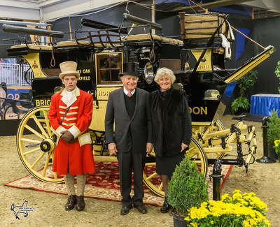 Harvey (center) and Mary (right) Waller with their historic road coach the 'Old Times,' winner of the Green Meadows Four-In-Hand Coaching Appointments class at the Royal Horse Show. Photo by Ben Radvanyi Photography (CNW Group/Royal Agricultural Winter Fair)
