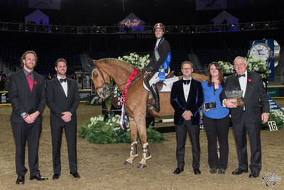 François Lamontagne of St. Eustache, QC, was presented with the Moffat Dunlap Leading Canadian Rider Award while his mount, Chanel du Calvaire, claimed the All-Canadian Cup as the leading Canadian-owned horse during the CSI4*-W Royal Horse Show. The All-Canadian Cup was presented by the Grange Family representing Lothlorien Farm of Cheltenham, ON. Photo by Ben Radvanyi Photography (CNW Group/Royal Agricultural Winter Fair)