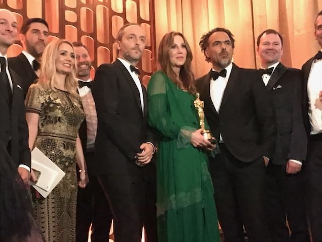 Legendary Entertainment Vice Chairman Mary Parent, director Alejandro G. Iñarritu, and a cinematographer Emanuel Lubezki take a photo at the Annual Governors Awards.
