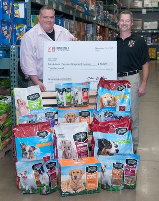 Rich Amigone, general manager of the BJ's Wholesale Club in Westminster presents a $10,000 grant to Monty Moore, president of the Mid-Atlantic German Shepherd Rescue.