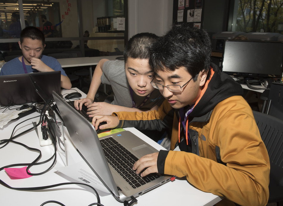 Kevin Shen (left) and Claude Zou from Poolesville High School, Poolesville, Maryland, use their digital skills to solve a murder mystery and capture second prize in the North American High School Forensics Challenge of the world's largest student-led cybersecurity games, NYU CSAW (Cyber Security Awareness Week). Founded at NYU Tandon, the games have expanded to universities on three continents.