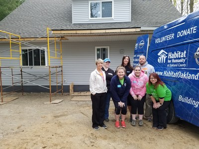 Chase employees working hard during Habitat for Humanity day.
