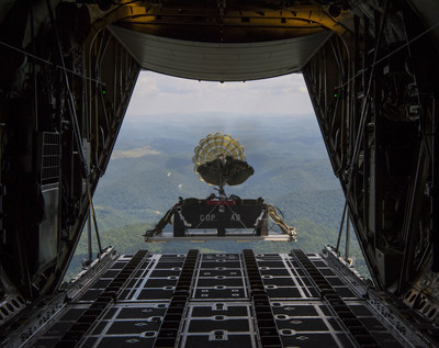 A U.S. Air Force C-130H drops an airdrop platform with a heavy equipment training load on Aug. 8, 2017 during a local training mission.  (U.S. Air National Guard Photo by Airman Caleb M. Vance)