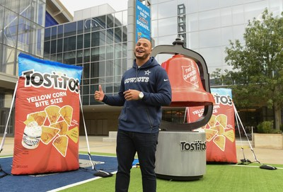 Dallas Cowboys quarterback Dak Prescott helps Tostitos kick off its partnership with the Salvation Army on Tuesday, Nov. 14, 2017 at Tostitos Plaza at The Star in Frisco, Texas, home to the Dallas Cowboys world headquarters.