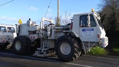 Photo 1: Two Vibroseis trucks, which stop every few metres for half a minute or so to produce the source vibrations. (CNW Group/Hannan Metals Ltd.)