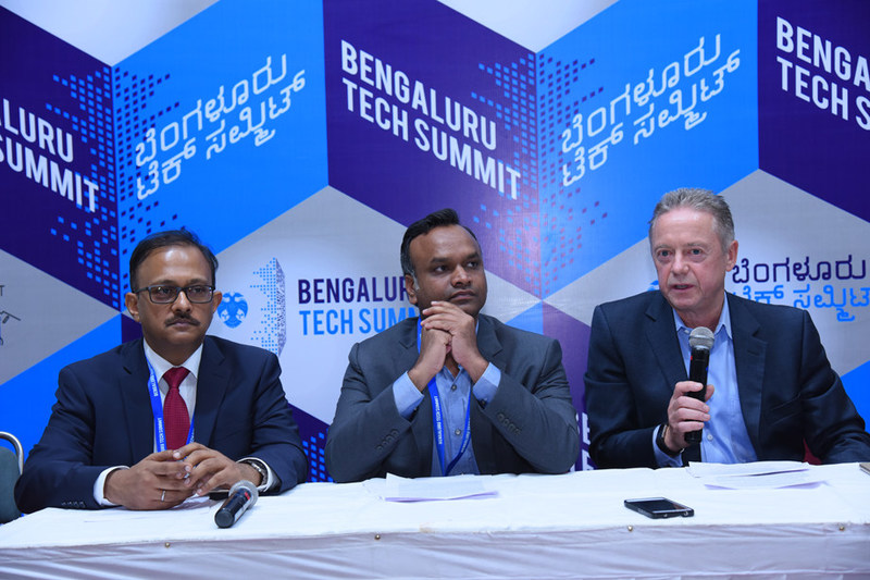 Hon. Minister Priyank Karghe, ITBT & Tourism, Government of Karnataka and Nick Earle, SVP Global Field Operations, Virgin Hyperloop One signing a MoU for a preliminary study in the region