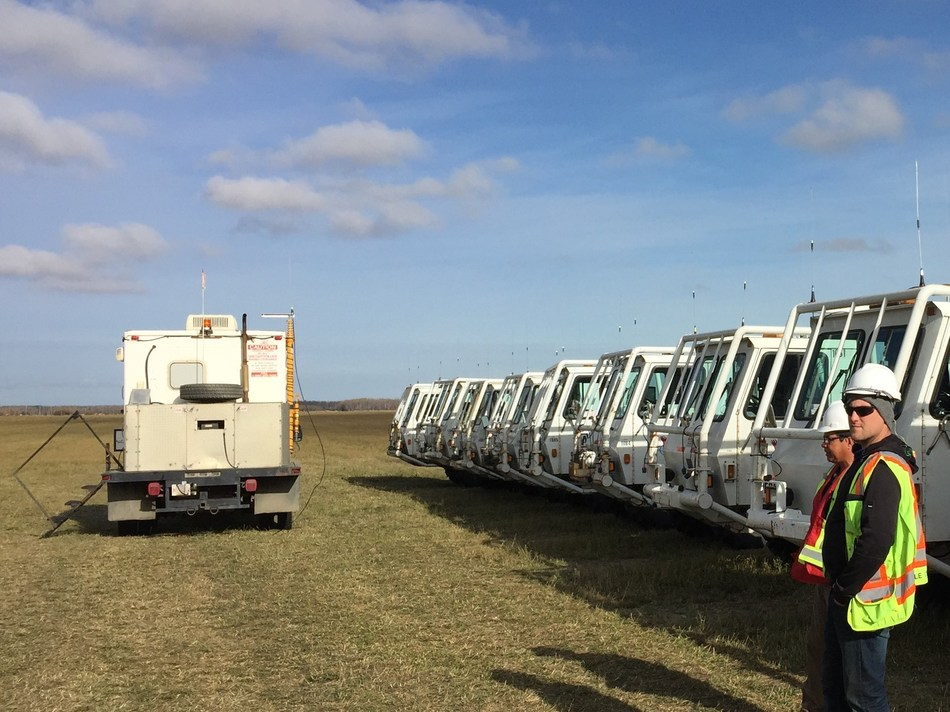 Fleet of seismic vibrators preparing for operations on Explor high density seismic project. (CNW Group/Explor)
