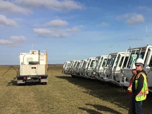 Fleet of seismic vibrators preparing for operations on Explor high density seismic project. (CNW Group/Explor)