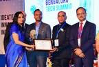 LendFoundry's Co-Founder Ms. Anubha P. receiving the Woman Entrepreneur of the Year Award, by Shri Priyank Kharge, Hon'able Minister of IT, BT & Tourism, Government of Karnataka and Mr. Suvarna Raju, Chairman & Managing Director Hindustan Aeronautics ltd. (PRNewsfoto/Sigma Infosolutions Ltd.)