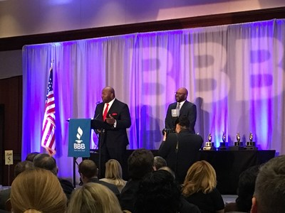 Corey Williams, Vice President and Regional Director at Combined Insurance, accepts the Better Business Bureau of Chicago and Northern Illinois' 2017 Honorable Mention Torch Award on behalf of the company.