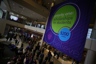 A sign hangs from two floors of the Anderson Student Center during a launch event for a new Student Achievement and Success initiative November 16, 2017. The initiative seeks to raise $200 million for student scholarships and was kicked off by a $50 million donation by the GHR foundation.