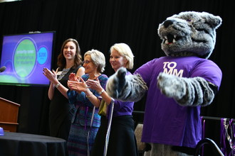 Left to right, Amanda Post, President Julie Sullivan, GHR Foundation head Amy Goldman and Tommie the Tomcat gather on stage to push a button releasing confetti in the Anderson Student Center atrium at the launch of the Student Achievement and Success campaign on November 16, 2017, in St. Paul. The $200 million campaign was kicked off with a $50 million donation by the GHR Foundation.