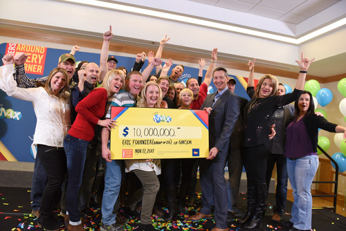 OLG's Executive Director of Marketing and Product Management celebrates a $10 million win with a group of 26 neighbours and best friends from Garson. The group won the October 13, 2017 LOTTO MAX jackpot. (Photo Credit:  Shan Qiao) (CNW Group/OLG Winners)