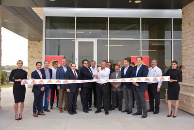 Juan González Moreno, President and General Director of Gruma, accompanied by Texas Secretary of State, Rolando B. Pablos, cuts the ribbon at the ceremony for the opening of the new Mission Foods plant in Dallas, Texas.