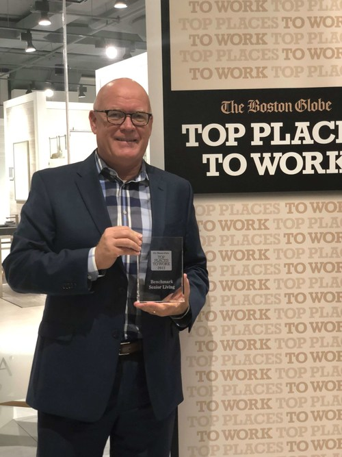 """Vice President of Human Resources Tim Reilly accepts the award for Benchmark Senior Living, named #10 in The Boston Globe's """"Large Company"""" Top Places to Work - making the list for the 10th consecutive year."""
