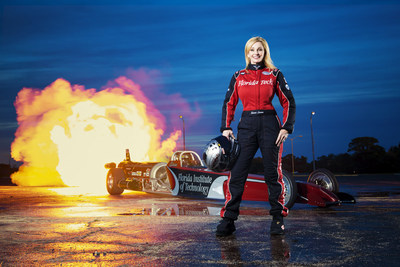 World champion jet dragster driver Elaine Larsen, shown with her Florida Institute of Technology dragster, can help drivers of all sorts safely navigate the busy holiday shopping and travel season.