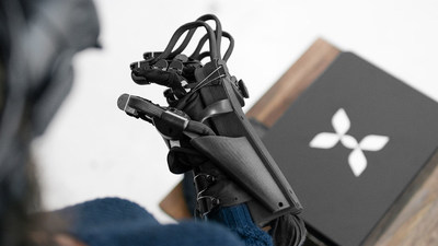 A view of the HaptX Glove prototype and its console