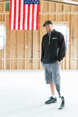 U.S. Army Staff Sgt. Jesse Clingman in his new garage and workout space constructed through Carrington Charitable Foundations and its signature program Carrington House. Photography by Seymour Sport.