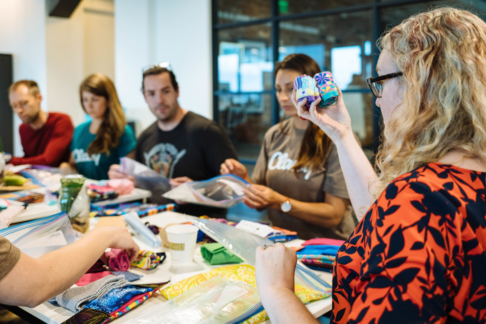 A Days for Girls volunteer visits Classy in San Diego, California, to teach employees how to assemble DfG Kits in preparation for Classy's new philanthropic initiative, ClassyGives.