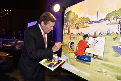 Mayor John Tory assists artist Peter Farmer in painting a Toronto park scene at tonight's Mayor's Evening for the Arts. The event raised money in support of Arts in the Parks, an initiative of the Toronto Arts Foundation that brings free arts programs to parks across Toronto. (CNW Group/Toronto Arts Foundation)
